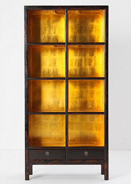 Bookcase Back Panel Ideas: Add a golden glow to your bookcase by covering the back panel in gold leaf or metallic wallpaper.