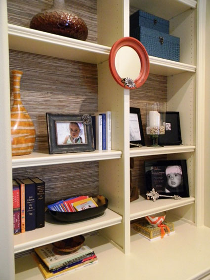 Bookcase Back Panel Ideas: Use grasscloth on the back panel to bring texture and interest to a bookcase or built-ins.