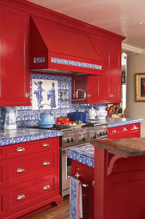 Red Rooms: Decorating With the Color Red - Bright red kitchen cabinets with blue and white patterned tile backsplash and countertops