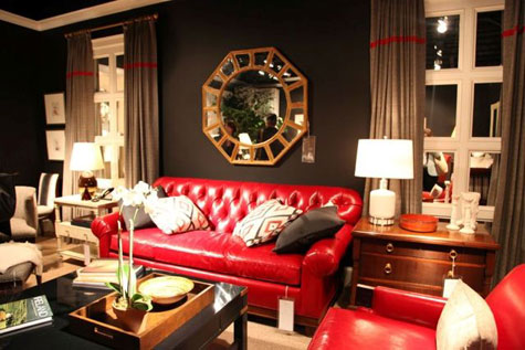 Red Rooms: Decorating With the Color Red - A living room with a red leather Chesterfield sofa and brown walls