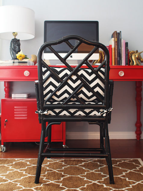 Red Rooms: Decorating With the Color Red - A high-gloss red metal desk and black chair in a home office