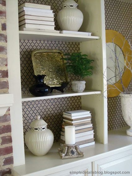 Bookcase Back Panel Ideas: A couple of rolls of wrapping paper and some Mod Podge are an inexpensive way to transform a bookcase. Use them on the back panel for an instant and easy update.