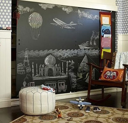 Closet Door Ideas: Use black chalkboard paint to turn flat panel closet doors into a super-sized canvas in a kid's bedroom or play area.