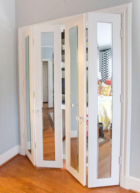 Closet Door Ideas: Adding slim full-length mirrors to flat closet doors and trimming them out with molding is a great way to bring a contemporary vibe to a room and make it seem larger.