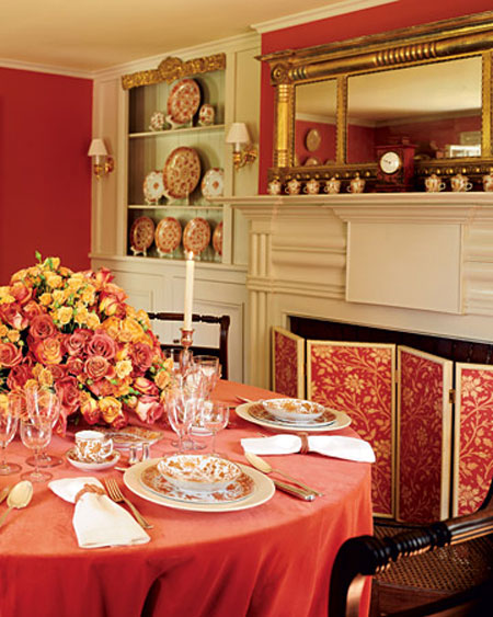 Choosing Colors for Rooms: This traditional dining room is decorated in the most popular color for dining rooms, red.