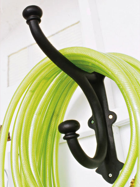 Organizing Tips for Garden Tools: It's easy to trip on a coiled hose that's lying on the floor of the garage or garden shed. Get it up off the floor by utilizing a large hook. Make sure you choose a hook with a steep angle so it holds the hose in place.