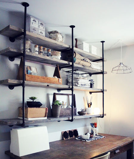 "DIY Shelving Ideas: Plumbing parts and ""aged"" wood shelves combine to create a trendy industrial rustic shelf unit. You can find everything you need at your local home improvement store. Industrial Rustic Shelf Unit Tutorial"