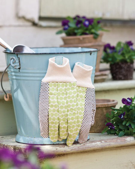 Organizing Tips for Garden Tools: Don't worry about misplacing your garden gloves with this idea. Sew a magnet into the cuff of each glove. They'll easily attach to a metal garden bucket or a metallic tool strip.
