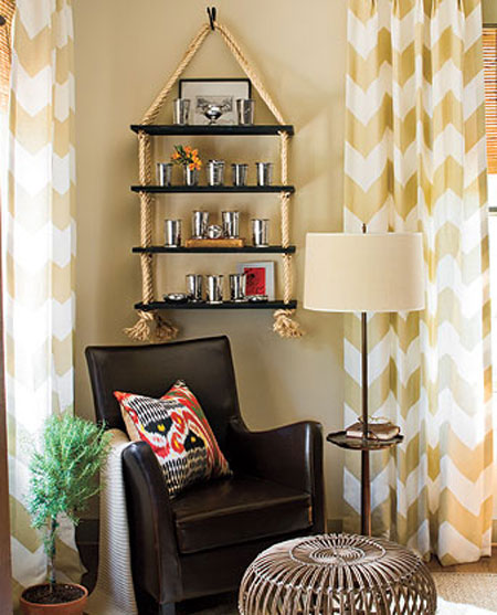 DIY Shelving Ideas: This fabulous rope shelving was made for less than fifty dollars. It adds so much character and style to a space and looks like it came from a high-end boutique. Rope Shelf Tutorial