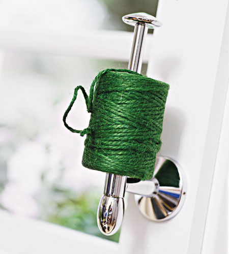 Organizing Tips for Garden Tools: Tired of having to search high and low for string when you need it? Turn a toilet paper holder on its side, and then use it to keep string handy and ready for cutting. This also works for twine and wire.