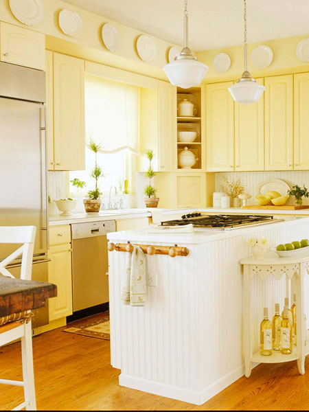 Choosing Colors for Rooms: Cabinets painted in a cheery yellow brighten up a kitchen.