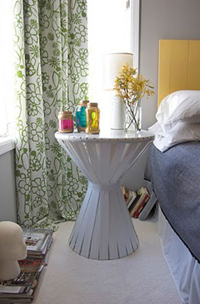 DIY Projects: Creative Furniture Ideas - The need for a functional and tall bedside table was the inspiration for this creative design. It's amazing what you can do with a cardboard building tube, a couple of wood circles and shiny vinyl strips. DIY Bedside Table Tutorial