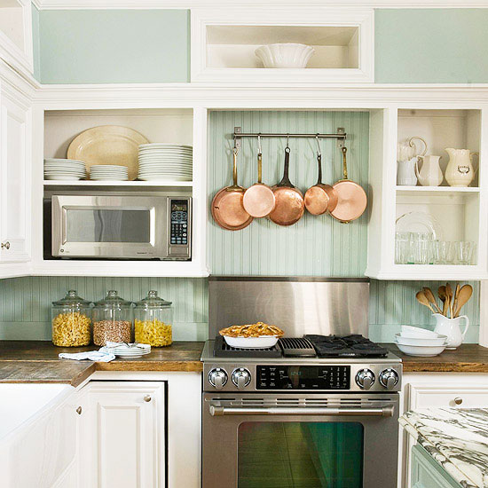 Open Kitchen Shelving Tips and Inspiration: White upper cabinets with the doors removed to create open shelving, robin's-egg blue beadboard backsplash