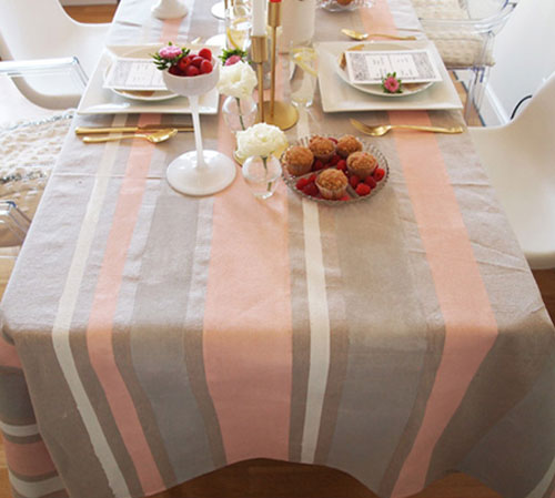 DIY Crafts: Make Your Own Tablecloth - Another fantastic way to use a painter's drop cloth in your home decor is as a tablecloth. Customize yours by painting it with stripes using regular interior paint. Painted Drop Cloth Tablecloth Tutorial