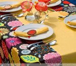 DIY Crafts: Make Your Own Tablecloth - Give your dining room a colorful boost with this bright and cheery tablecloth. What sets it apart from others is that the runner is built-in. This creates a focal point and sets the stage for a fabulous center piece. Built-In Runner Tablecloth Tutorial