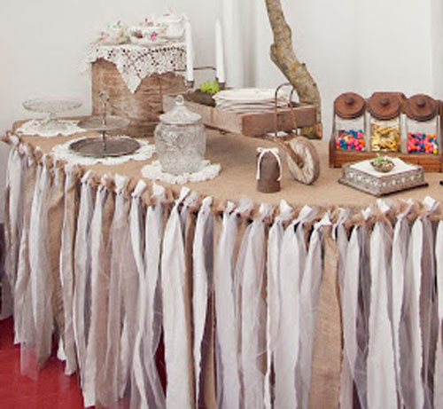 DIY Crafts: Make Your Own Tablecloth - Here's another fun way to decorate with burlap. Cut it in strips and use them to skirt a tablecloth. To give it extra pizzazz, the burlap strips are mixed with fabric strips and toile. You can have so much fun with this! Ruffled Rags Tablecloth Tutorial