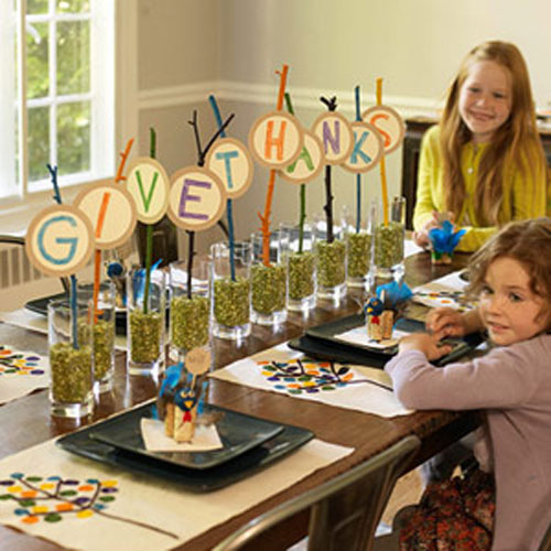 Kids Thanksgiving Table Ideas: Create a unique centerpiece with tall glasses, lentils and letters on a stick.