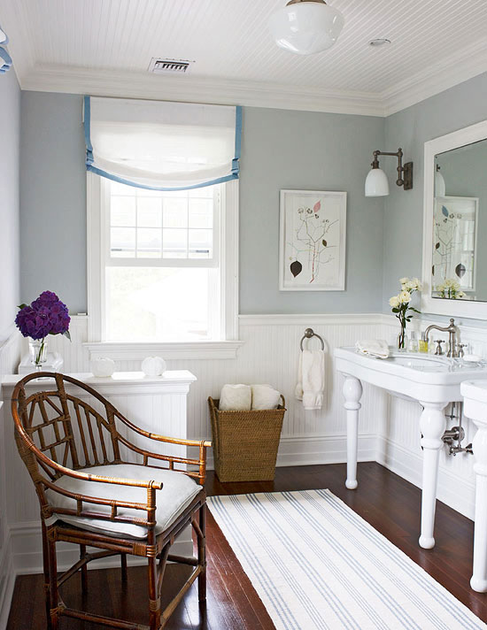 Cottage Style Homes: Two-legged sinks continue the vintage charm in the master bathroom.