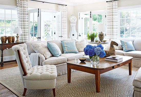 Cottage Style Homes: Lots of windows allow plenty of natural light in this living room.
