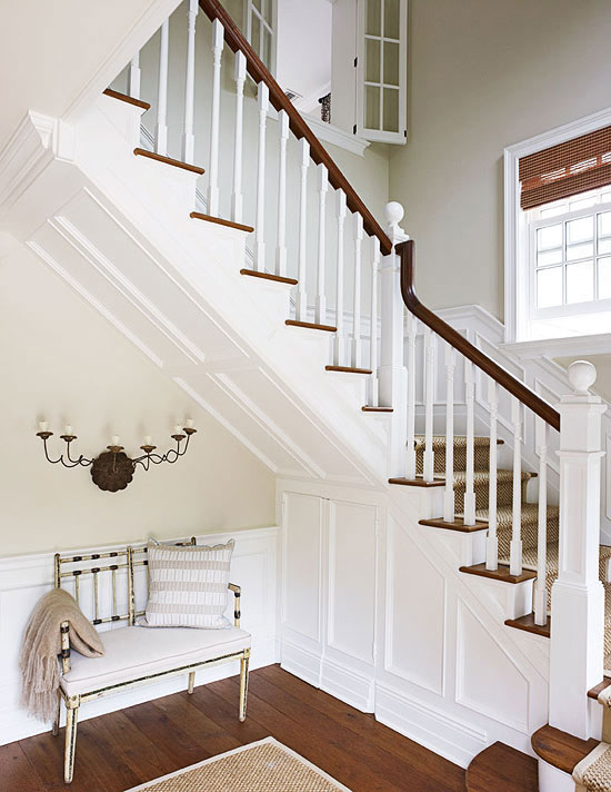 Cottage Style Homes: The two story foyer now boasts a new staircase.