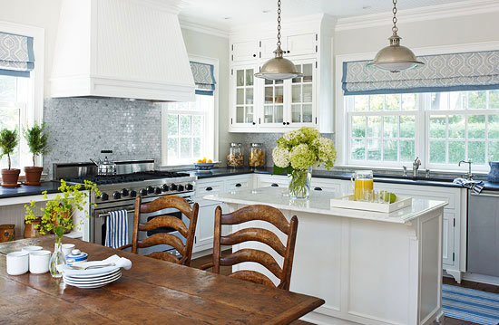 Cottage Style Homes:  The white kitchen has all the modern conveniences, but maintains the integrity of the home's past.