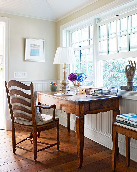 Cottage Style Homes: An antique wood table from France serves as a desk in the pantry.